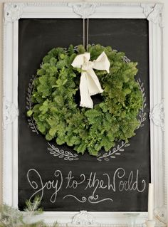 wreath on a framed chalkboard