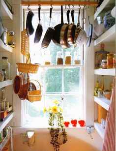 I almost think our pantry could become this pantry if a window were magically added.  Sigh...