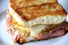 hawaiian grilled cheese1 stick of butter 1/3 cup parmesan cheese dash of worcestershire 2 tbsp minced shallot 1 1/2 tbsp Grey Poupon mustard pineapple deli ham Hawaiian bread