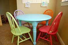 LOVE this repainted table and chairs. It would look cute for kids play room. Would even look cool if you painted the top with chalkboard paint for teaching your kids and for play time :-)