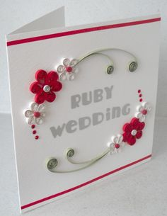 Quilled anniversary card, ruby wedding, congratulations, paper quilling A beautiful quilled ruby wedding anniversary card, with quilling flowers. A square white textured background car. Quilling Birthday Cards, Paper Quilling Cards, Paper Quilling Patterns, Paper Quilling Flowers, Quilling Craft, Handmade Birthday Cards, Handmade Cards, Ruby Wedding Anniversary, Anniversary Cards For Couple