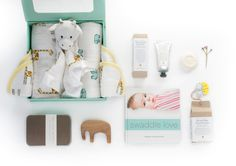 For New Beginnings  aden + anais new beginnings gift set  - The Aromatherapy Co. Therapy Baby. Boxed Soap 80G containing a  blend of organic lavender essential oil with vitamin E, goat's milk and olive oil to help replenish & moisturise, Therapy Baby. Botty Balm 75mls containing natural healing properties for all skin rashes, irritations or extreme dryness.- Traditionally crafted Milton Ashby Elephant made from walnut wood and finished with Livos natural oil, giving a satin gloss finish.