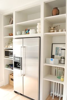 built-in fridge with open shelving surrounding