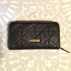 Price Drop Steve Madden Wallet. Black w Metal Steve Madden Wallet. Black w Metal Studs exterior and metallic and leopard interior lining.   Fair condition. Little bit of wearing on the outside edges (see picture). ⚡️Fast Shipper  Bundle Discounts Steve Madden Bags Wallets