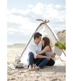 tent on beach. Love how they used driftwood