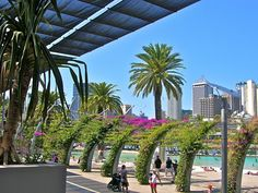 Brisbane, in Queensland , Australia is an amazing and surprisingly beautiful city! We had a house sit near the South Bank where we often swam at the Street Beach just across the river from the downtown business district. Love the arches full of hot pink flowers that creates an amazing walkway through the area.
