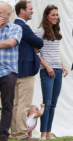 The future king of England tries to eat his mother's pants.