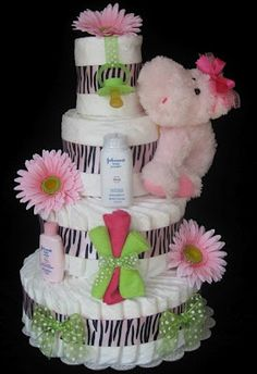 Diaper Cake idea perfect for a girl. I think it needs sparkles somewhere.