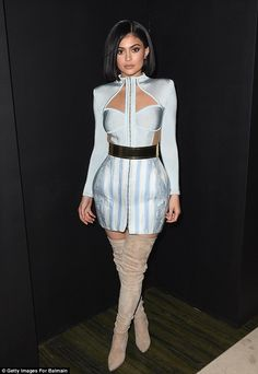 Fashion victim: Kylie Jenner brushed off her bruised feet and scraped legs - due to her he...