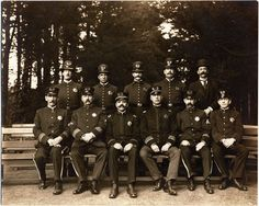 """Members of the San Francisco Police Department - """"Front row - 3rd from left - Lieut. J.H. Lachman, 4th from left - Capt. H. Gleeson, 5th from left - Sgt. P.H. McGee.""""   (San Francisco Public Library)"""