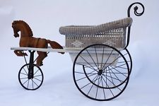 antique baby stroller with horse -