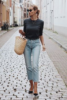 Black elbow sleeve t-shirt, light wash crop skinny jeans, black suede kitten heels, black cat eye sunglasses, straw tote bag. Spring outfits, casual outfits, fashion trends 2018, casual outfits, simple outfits, #fashion2018 #casualstyle #springstyle #streetstyle #ootd #minimaliststyle #fashionblogger