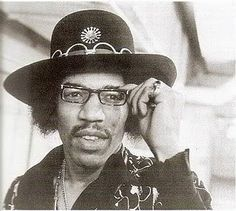 Jimi Hendrix in a rare pic wearing glasses. Jimi had bad vision and wrecked many cars because he refused to wear glasses. It didn't hurt his guitar playing.