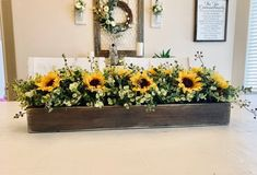 Sunflower Floral Arrangement, Farmhouse Kitchen Island Centerpiece, Fall Dining Room Table, Rustic Floral Arrangement, Mantle Decor - This is a gorgeous farmhouse inspired centerpiece with greenery and sunflowers perfect for summer o - Sunflower Table Centerpieces, Sunflower Floral Arrangements, Table Centerpieces For Home, Wooden Box Centerpiece, Summer Centerpieces, Centerpiece Decorations, Summer Table Decorations, Rustic Centerpieces, Christmas Decorations