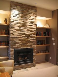 Install electric firplace. Create faux stone surround. Downcast pot lighting in the soffit above shelving...nice touch.