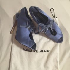 "Manolo Blahnik blue satin heels Blue satin 4"" peep toe heels with velvet tie. Only worn a handful of times. Slightly worn on the soles but overall in good condition. Runs a little small. I am a 9.5 usually and these fit me perfectly. Includes dust bag Manolo Blahnik Shoes Heels"
