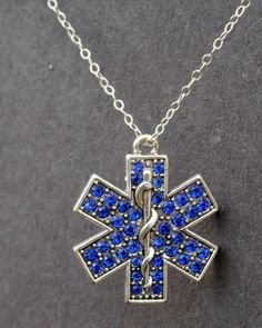 Sterling Silver Plated EMT Logo with Crystals Inset on Etsy, $30.00