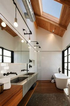 A skylight illuminates this neutral bathroom letting bathers contemplate the clouds.