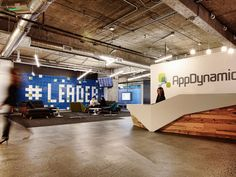Wood, solid surface reception desk. Fennie + Mehl Architects - AppDynamics Headquarters