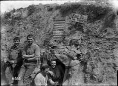 Soldiers with a corrugated iron sign reading 'The Cannibals Paradise Supply Den Beware', 10 August The sign was created in response to German propaganda that the New Zealanders ate their captured prisoners. World War One, First World, School Kit, Lest We Forget, Military Personnel, Historical Images, Military History, World History, Wwii