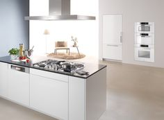 Forget stainless steel. The brilliant white collection by Miele accentuates the cool, puristic design of the kitchen. A dramatically chic design statement.   Miele brilliant white collection.