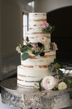 This tastefully naked cake. | 25 Incredibly Beautiful Wedding Cakes That Won 2015