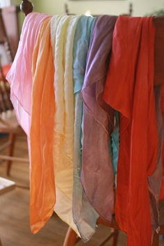 DIY play silks by supergail, via Flickr {These play silks can be really pricey, but she has a link for cheap white ones and then a link for a tutorial about how to dye them fun colors. WAY cheaper option!}