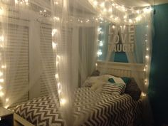 Teen bed with canopy net and fairy lights.