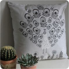 Beautifully designed peacock cushion by Rebecca Sodergren.   Looks wonderful in a grey, scandi interior.  #stylishinteriors #scandidesigns #cushion  #greyinteriors #peacock