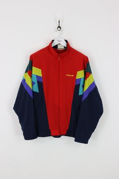 "Very good condition, vintage Adidas shell suit jacket. Measurements: Pit to pit - 23"" Length on back - 28"" Vintage items will usually show a few signs of wear"