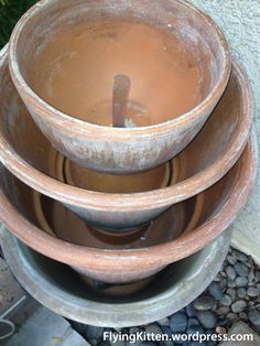 How To Make A Clay Pot Fountain this is a great step by step with pics!
