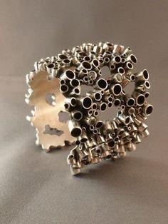 Amazing bracelet, sterling silver bracelet formed with tubes. Stunning statement cuff bracelet.