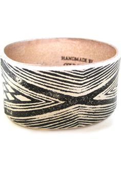 Cold Picnic Leather Textile Bangle - crudely beautiful and imperfectly modern, this bracelet has an organic rawness that compliments most any summer ensemble. It feels like a tribal relic, a huntress' badge of honor. The pattern suggests the unique lines of a fingerprint, made by a poorly-inked rubber stamp...the geometry feels like a remnant from an ancient culture, yet it remains distinctively modern. Artistically androgynous with detail that is both delicate and rugged. #r29summerstyle