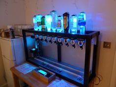 http://www.theinebriator.com/  http://www.gizmag.com/somabar-robotic-mixer-craft-cocktails/35080/