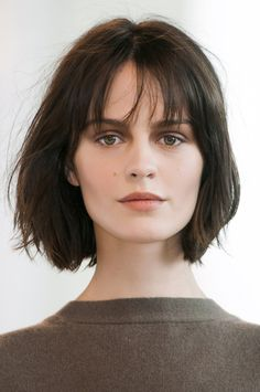 Medium-short-hairstyle-with-wispy-bangs