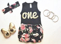 "This set includes a black and gold ""one"" tank, headband and bloomers!"