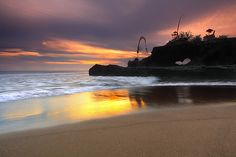 Dedicated to my photo guru  🙂 Yeh Gangga beach is 10km SW of Tabanan, Bali. The attraction of this area is natural beauty, with rice fields leading down to the black sandy beach and a rugged, empty coastline. Yeh Gangga beach, like many of the beaches on the west coast Bali, is not suitable...