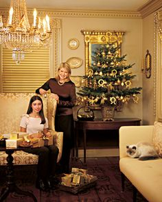 Martha and her niece Kristina wrap presents and trim the small spruce.