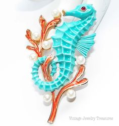 Vintage Crown TRIFARI Alfred Philippe Coral Enamel Pearl Aqua Sea Horse Pin RARE FIND Under the Sea Collection. Sold for $ 299.99, via Etsy.