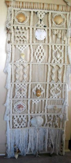 Vintage Macrame wall hanging with bamboo and accentuated with sea shells made in the 1960s.