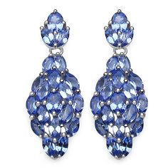 Each of these earrings features a dangling cluster of rich lavender tanzanite gemstones in marquise and oval cuts. These dangle earrings are crafted of .925 sterling silver and secure with butterfly clasps.