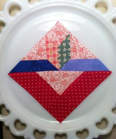 """Block #96 """"Tulip"""", super easy to piece, straight lines and looks great in primary colors and on point."""