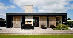 Black exterior + wooden exterior shutters. Ginneruparkitekter - Denmark