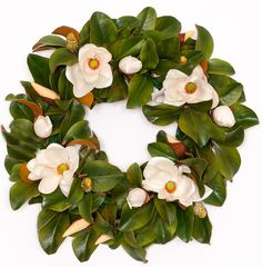"This gorgeous silk magnolia wreath is 30 inches across and filled with beautiful magnolia leaves, buds and flowers. It is perfect for any season, indoor and outdoor. Features - 30"" diamater magnolia w"