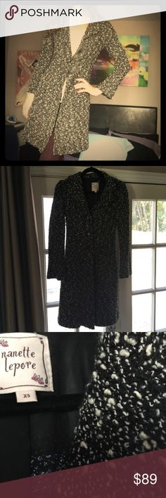 🎀 Nanette Lapore 🎀 Duster 🎀 Nanette Lepore 🎀 Duster in black and cream. Black floral designed buttons. 2 small, yet convenient pockets at the hips. Barely worn. In great condition  👍 54% Acrylic 49% Wool, remainder is nylon. Lining is 100% Polyester. Dry Clean Only. Made in the 🇺🇸 Nanette Lepore Jackets & Coats