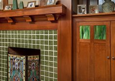 COLOR: green tiles; green glass in the natural-wood cabinet doors; fabulous stained glass firescreen.