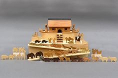 Hey, I found this really awesome Etsy listing at http://www.etsy.com/listing/61129849/miniature-noahs-ark-with-60-animals