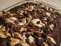 Earthquake Cake!  coconut on the bottom, topped with chocolate chips, topped with pecans,   topped with chocolate cake batter    topped with a mixture of butter, confectioner's sugar and cream cheese poured on top