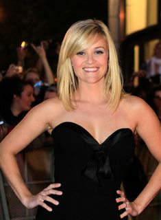 Reese Witherspoon Sophisticated, Tousled, Straight Hairstyle with Bangs