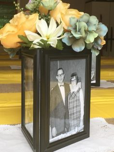 3 frames from dollar store duct taped together for great center pieces.